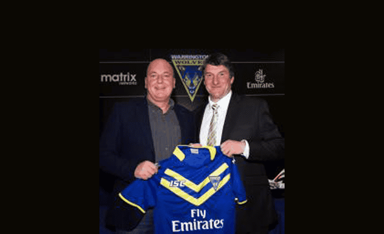 Mark Thomas Cortech Director is presented with the new 2014 Wolves home shirt by Warrington Wolves
